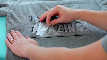 Peeling the plastic backing off your HTV design