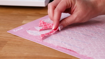 Pulling off excessive material from your pink Cricut mat