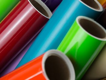 A display of color rolls of vinyl for cutting.