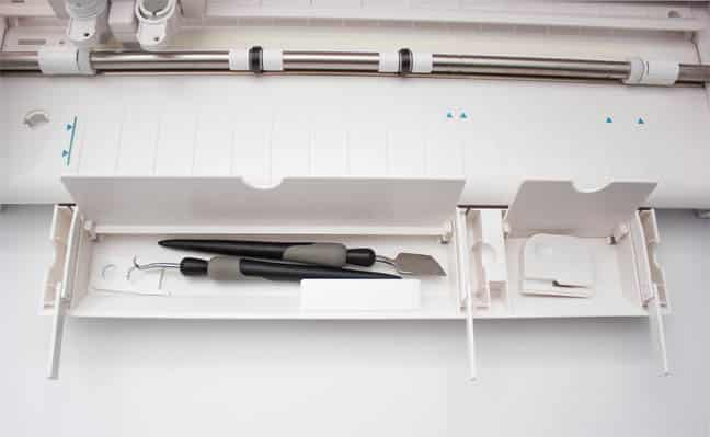 bottom storage compartment on Silhouette Cameo 3, with flip out arms to support the cutting mat