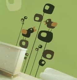 Vinyl bird decals on a green wall.