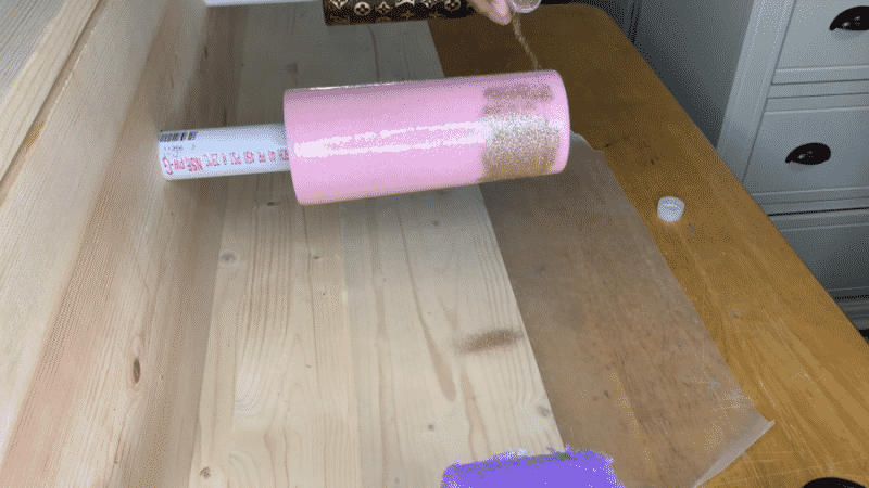 Applying additional glitter to the tumbler