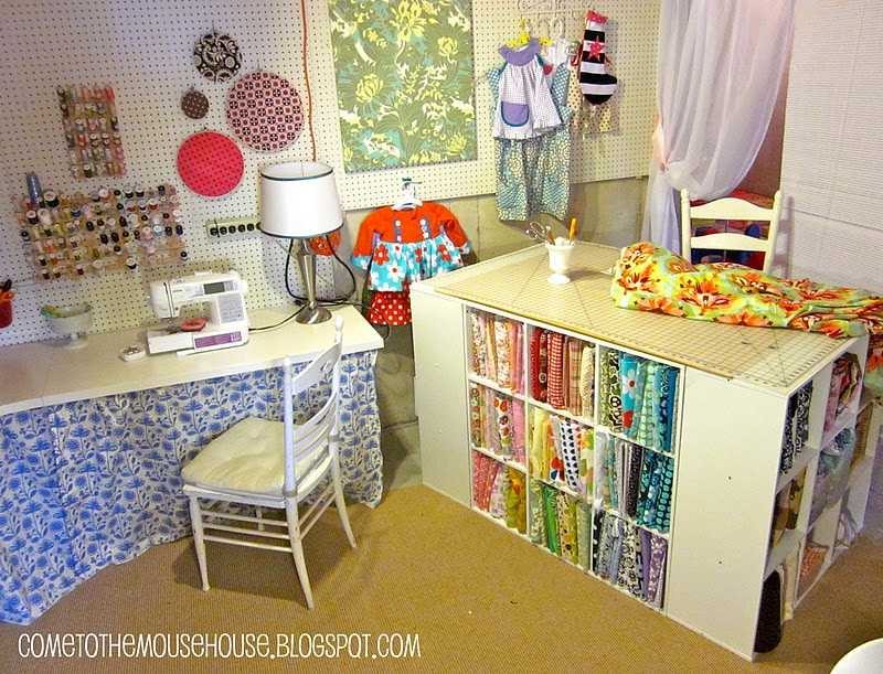 Basement sewing studio filled with fabrics and crafting tools