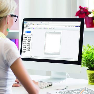 A woman uses Brother CanvasWorkspace on her Mac.