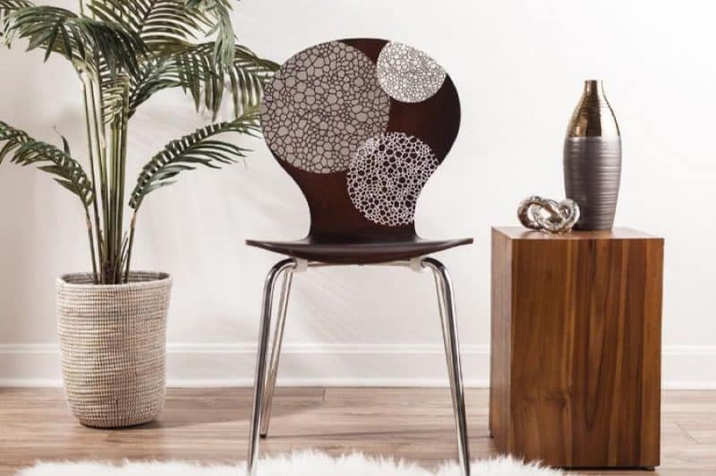 A wood chair decorated with vinyl