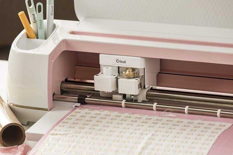 A Cricut cutting machine using its dual carriage.