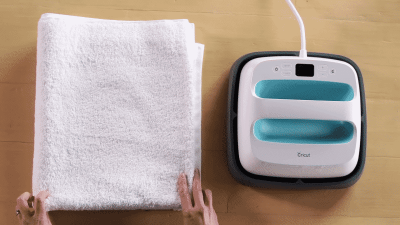 You can use a folded towel as your pressing surface with an EasyPress or household iron.