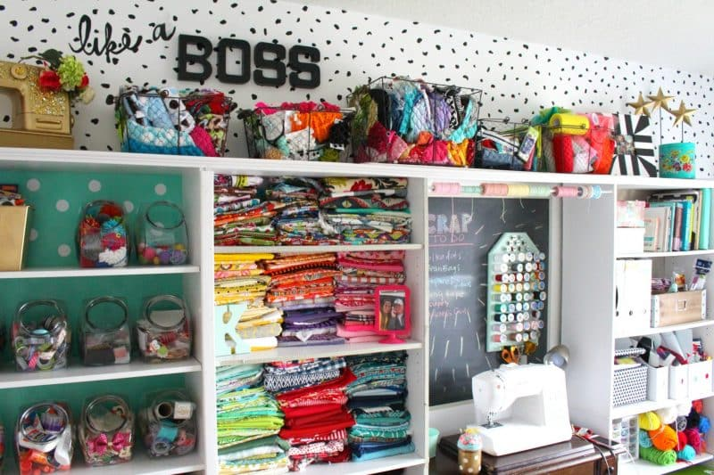 Colorful sewing wall filled with fabrics