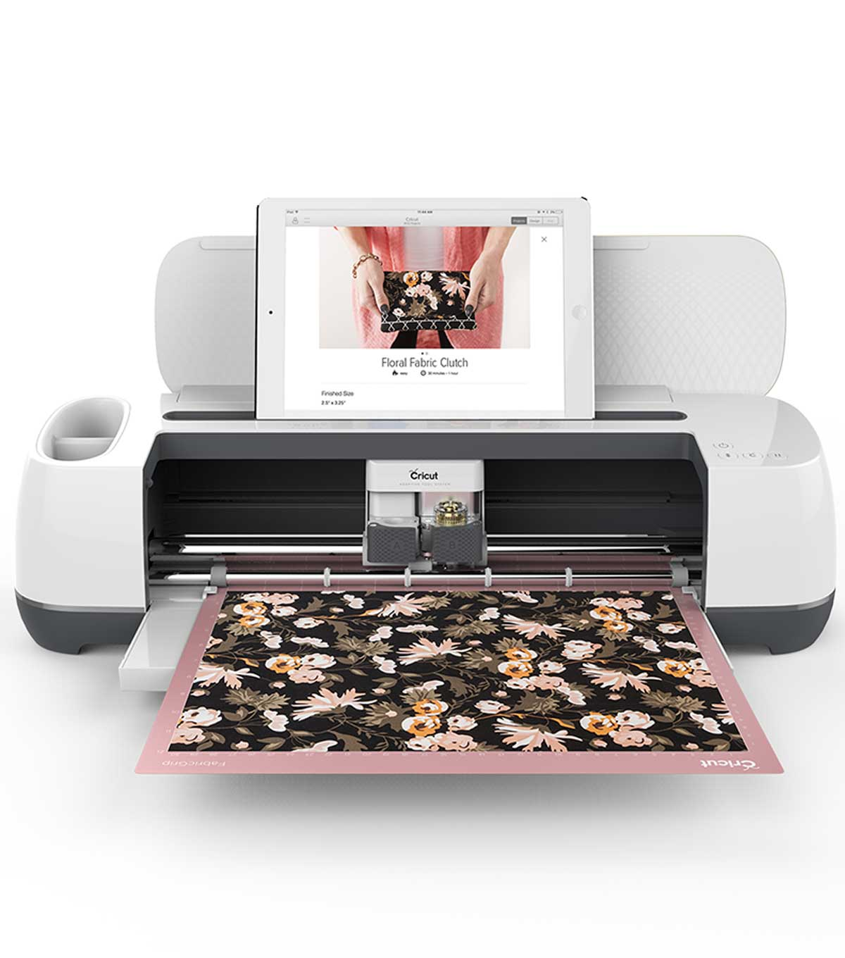 The Cricut Maker cuts out a beautiful floral pattern, with an iPad sitting comfortably on top.