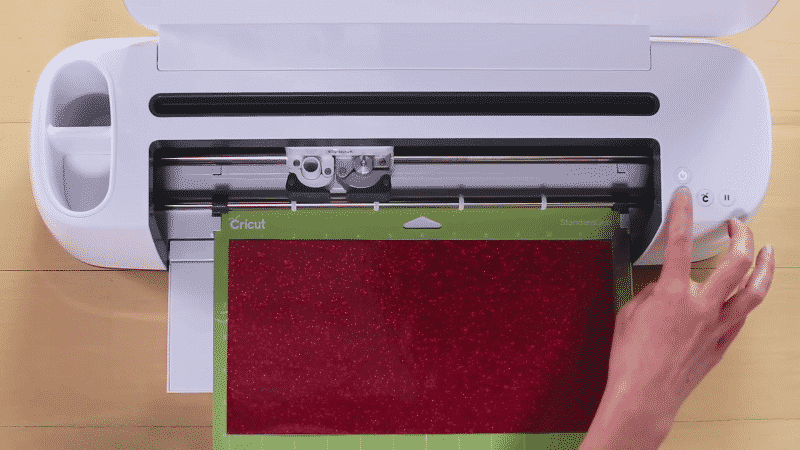 Press the up-down arrow button to load the cutting mat into your Cricut cutting machine.