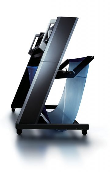 A gorgeous side view of a high end professional plotter with stand and catch basket.