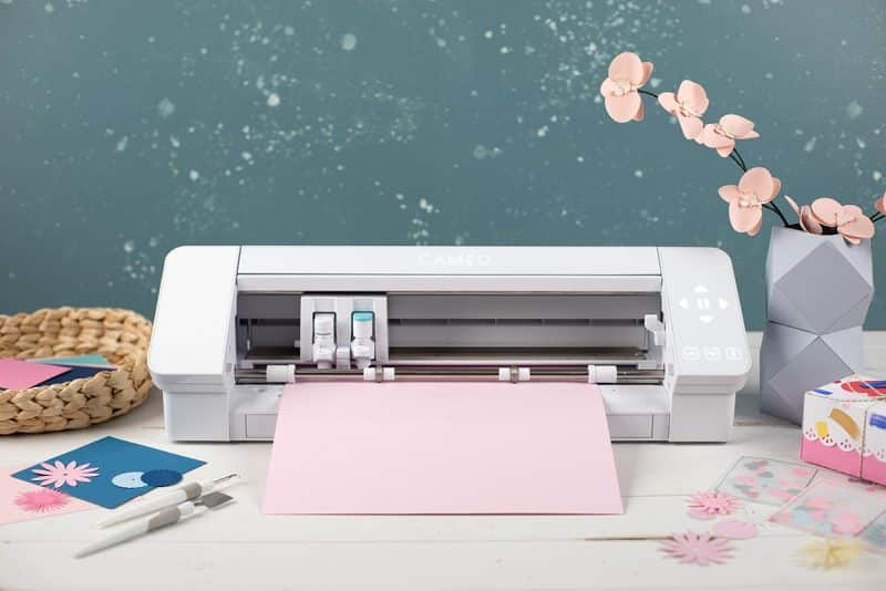 The Silhouette Cameo 4 on a table, ready to print